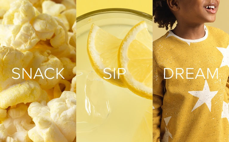 Popcorn, lemons, and a young girls wearing a yellow sweater with white stars